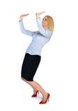 Geschäftsfrau, die etwas anhebt Lizenzfreies Stockfoto