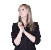 Geschäftsfrau, die an etwas denkt Stockfotografie