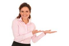 Geschäftsfrau, die etwas vorstellt Lizenzfreies Stockbild