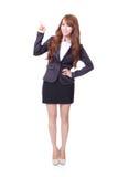 Geschäftsfrau, die etwas zeigt Stockfoto