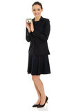 Geschäftsfrau, die Hausmodell hält Stockbild