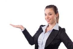 Geschäftsfrau, die heraus Hand anhält lizenzfreies stockbild