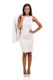 Geschäftsfrau, die ihren Mantel hält lizenzfreie stockbilder