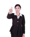 Geschäftsfrau, die Knopf oder etwas bedrängt Stockbild