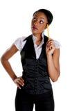 Geschäftsfrau, die mit einem Bleistift denkt Lizenzfreie Stockbilder