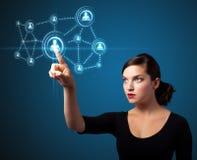 Geschäftsfrau, die modernen Sozialtypen der Ikonen bedrängt Stockfotografie