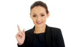 Geschäftsfrau, die oben zeigt Stockfoto