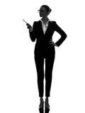 Geschäftsfrau, die Schattenbild zeigend zeigt lizenzfreie stockfotos