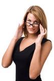 Geschäftsfrau, die Sie über Gläsern betrachtet. Lizenzfreies Stockfoto