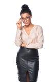 Geschäftsfrau, die skeptisch schaut Lizenzfreies Stockfoto