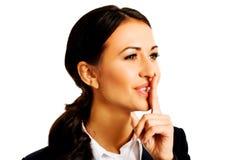 Geschäftsfrau, die stilles Zeichen macht stockfotos