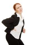 Geschäftsfrau, die unter den Schmerz leidet Stockbild