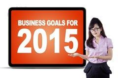 Geschäftsfrau, die Unternehmensziele für 2015 darstellt Stockfotos