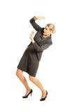 Geschäftsfrau, die versucht, sich zu schützen Stockbild