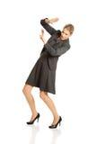 Geschäftsfrau, die versucht, sich zu schützen Lizenzfreies Stockbild
