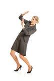 Geschäftsfrau, die versucht, sich zu schützen Stockfoto
