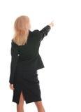 Geschäftsfrau eine Rückseite und Erscheinen beiseite eine Hand 2 lizenzfreie stockbilder