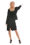 Geschäftsfrau eine Rückseite und Erscheinen beiseite eine Hand stockfoto