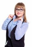 Geschäftsfrau in einem Hemd, in einer Weste und in Gläsern Stockfotografie