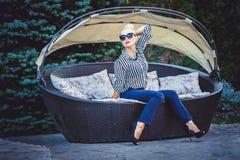 Geschäftsfrau in einem Stuhl Lizenzfreie Stockfotografie