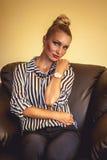 Geschäftsfrau in einem Stuhl Stockfoto