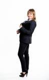 Geschäftsfrau in einer Klage mit der Tablette Lizenzfreie Stockfotos