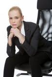 Geschäftsfrau gesetzt auf einem Stuhl Stockbild