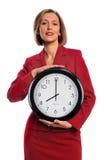 Geschäftsfrau-Holding-Borduhr Lizenzfreies Stockfoto