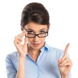 Geschäftsfrau Holding Eyeglasses Lizenzfreie Stockfotografie