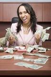 Geschäftsfrau Holding Money Lizenzfreie Stockbilder