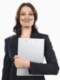 Geschäftsfrau Holding Pen Under Her Nose Lizenzfreies Stockfoto