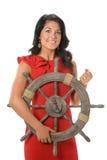Geschäftsfrau Holding Ship Wheel Stockbild
