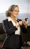 Geschäftsfrau im Büro Stockfoto