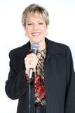 Geschäftsfrau im Schwarzen mit Mikrofon Lizenzfreie Stockbilder