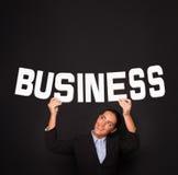 Geschäftsfrau mit dem Wort GESCHÄFT lizenzfreie stockbilder