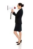 Geschäftsfrau mit einem Megaphon Lizenzfreies Stockfoto