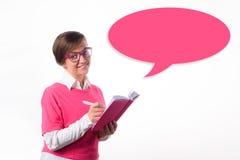 Geschäftsfrau mit einem Tagebuch schreibt in ein Tagebuch Stockfotos