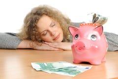 Geschäftsfrau mit einer piggy Querneigung Lizenzfreies Stockbild