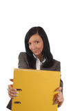 Geschäftsfrau mit gelber Datei Lizenzfreie Stockfotografie