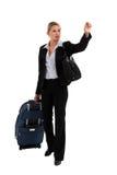 Geschäftsfrau mit hagelndem Taxi des Gepäcks Stockbild