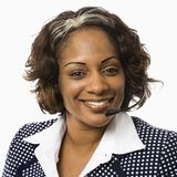 Geschäftsfrau mit Kopfhörer. Lizenzfreies Stockbild