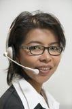 Geschäftsfrau mit Kopfhörer Stockbilder