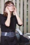 Geschäftsfrau mit Kopfschmerzen Stockbild