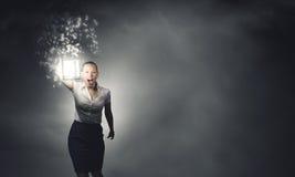 Geschäftsfrau mit Laterne Stockfoto
