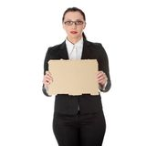 Geschäftsfrau mit leerem Pappzeichen Stockfotografie