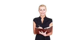 Geschäftsfrau mit Notizbuch Stockbild