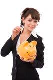 Geschäftsfrau mit piggy Querneigung stockbild