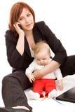 Geschäftsfrau mit Schätzchen Stockfotografie