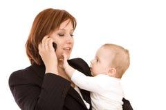 Geschäftsfrau mit Schätzchen lizenzfreie stockfotos