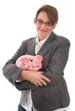 Geschäftsfrau mit Sparschwein - Frau lokalisiert auf weißem backgro Stockbild
